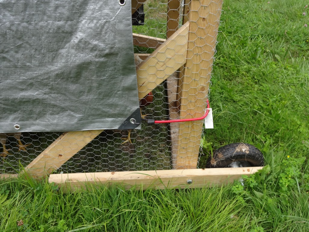 chicken tractor wheels. raise the lever to lower the wheel